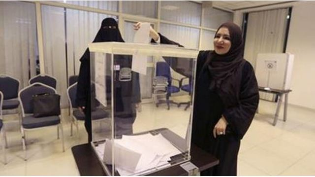 Saudi women vote for the first time, testing boundaries