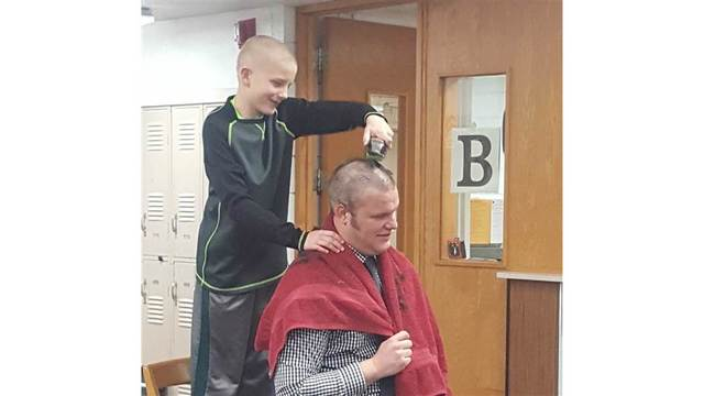 Principal steps up for a buzz cut to support student bullied over shaved head